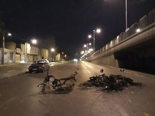 "In this Saturday, Nov. 16, 2019 photo, released by Iranian Students' News Agency, ISNA, scorched motorcycles remain on the street after protests that followed authorities' decision to raise gasoline prices, in the central city of Isfahan, Iran. Iran's supreme leader on Sunday backed the government's decision to raise gasoline prices and called angry protesters who have been setting fire to public property over the hike ""thugs,"" signaling a potential crackdown on the demonstrations. (Morteza Zangane/ISNA via AP)"