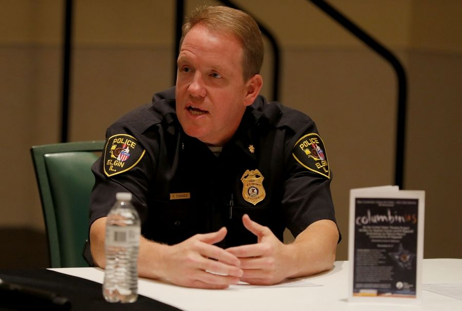 Elgin Police Commander Rick Ciganek speaks with other panelists during a community discussion Tuesday on the safety of youth and communities at The Centre of Elgin.