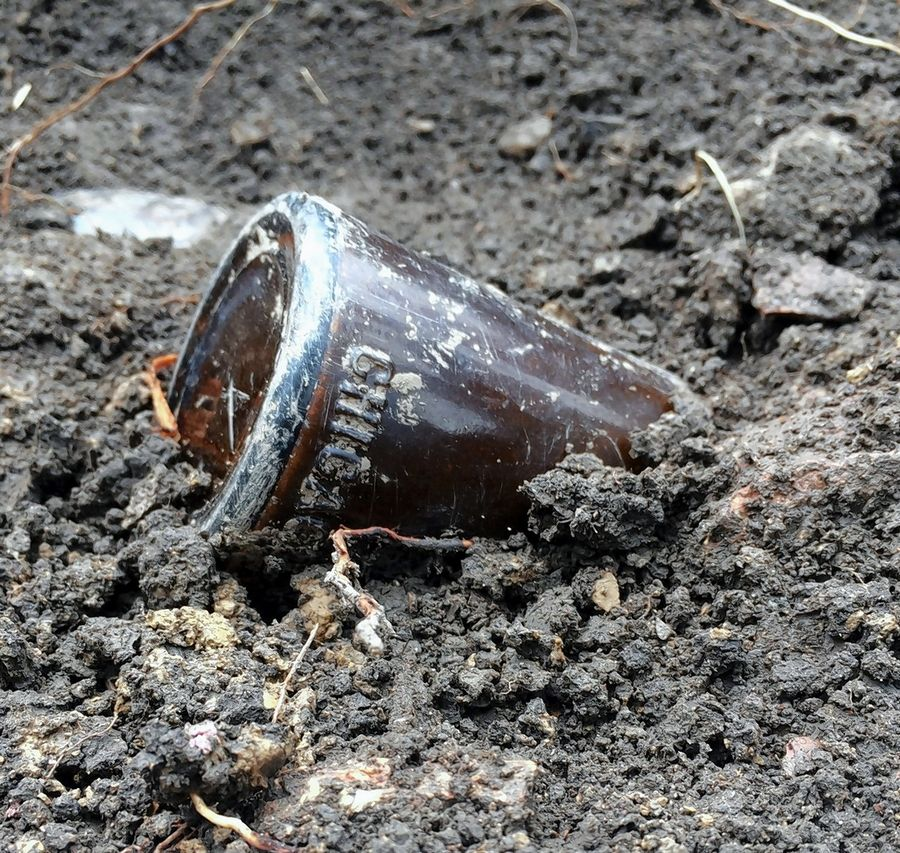 A brown bottle is among the items students have found during an archaeological dig at the site of a former African Methodist Episcopal Church on what is now the campus of Lake Forest College.