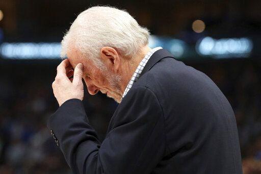 San Antonio Spurs head coach Gregg Popovich reacts near the end of an NBA football game against the Dallas Mavericks, Monday, Nov. 18, 2019, in Dallas.