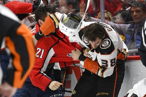 Washington Capitals right wing Garnet Hathaway (21) fights Anaheim Ducks center Derek Grant (38) during the second period of an NHL hockey game, Monday, Nov. 18, 2019, in Washington.