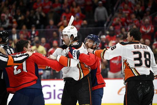 Washington Capitals right wing Garnet Hathaway (21) scuffles with Anaheim Ducks defenseman Erik Gudbranson, second from left, during the second period of an NHL hockey game, Monday, Nov. 18, 2019, in Washington. Also seen is Capitals center Chandler Stephenson, second from right, and Ducks center Derek Grant (38).