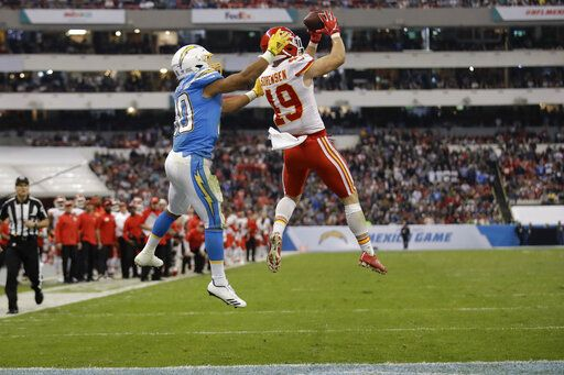 Kansas City Chiefs defensive back Daniel Sorensen, right, intercepts a pass intended for Los Angeles Chargers running back Austin Ekeler, left, during the second half of an NFL football game Monday, Nov. 18, 2019, in Mexico City.