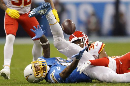 Los Angeles Chargers wide receiver Keenan Allen, left, can't make the catch as Kansas City Chiefs cornerback Charvarius Ward, right, defends, during the second half of an NFL football game Monday, Nov. 18, 2019, in Mexico City.