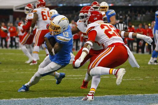 Los Angeles Chargers wide receiver Keenan Allen, left, scores a touchdown during the second half of an NFL football game against the Kansas City Chiefs, Monday, Nov. 18, 2019, in Mexico City.