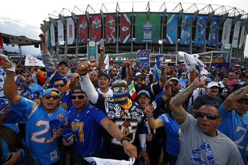 Fans cheer before an NFL football game between the Los Angeles Chargers and the Kansas City Chiefs Monday, Nov. 18, 2019, in Mexico City.