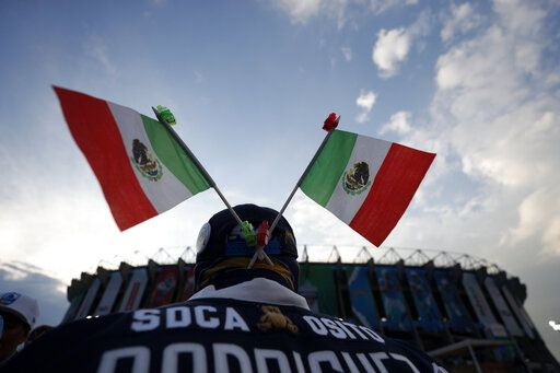Mexican flags adorn a fan's hat before an NFL football game between the Los Angeles Chargers and the Kansas City Chiefs Monday, Nov. 18, 2019, in Mexico City.