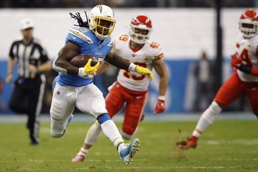 Los Angeles Chargers running back Melvin Gordon runs upfield during the first half of an NFL football game against the Kansas City Chiefs, Monday, Nov. 18, 2019, in Mexico City.