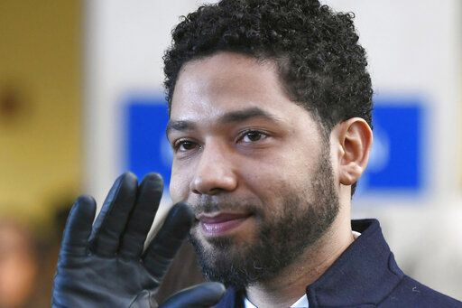 "FILE - In this March 26, 2019 file photo, former ""Empire"" actor Jussie Smollett smiles and waves to supporters before leaving Cook County Court after his charges were dropped in Chicago. Smollett says his $10,000 payment after the close of a criminal case should prevent Chicago from seeking reimbursement for a police investigation of his claim that he was a victim of a racist and homophobic attack. Smollett's attorneys filed a response to Chicago's lawsuit Tuesday, Nov. 19, 2019. They also filed a counterclaim against the city, saying Smollett was the victim of a malicious prosecution. Smollett told police he was beaten by two men. Police said it was staged."