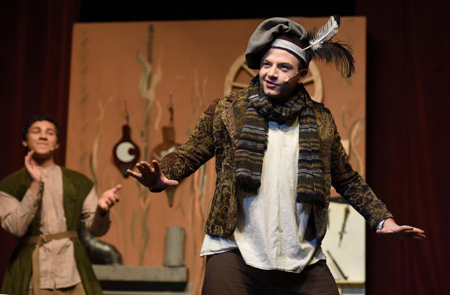 "Tristan Mesmer performs on stage, playing the part of overly confidant Nick Bottom, in Grant High School's rehearsal of ""A Midsummer Night's Dream, by William Shakespeare"" at the Fox Lake school Thursday."