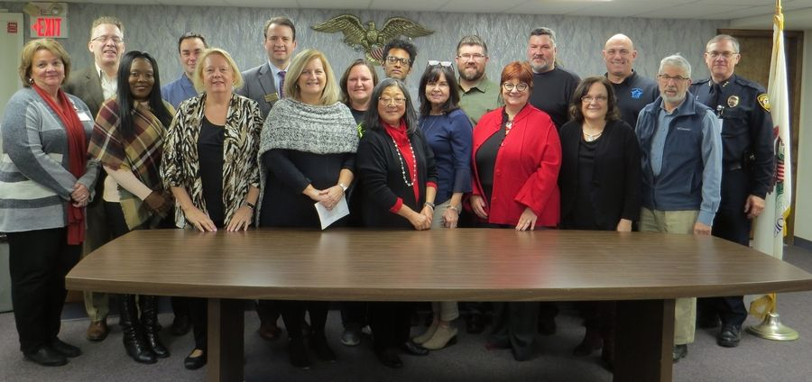 Bloomingdale Township Supervisor Michael D. Hovde Jr., back row, third from left, is joined by representatives from organizations receiving funding through the township's mental health board.