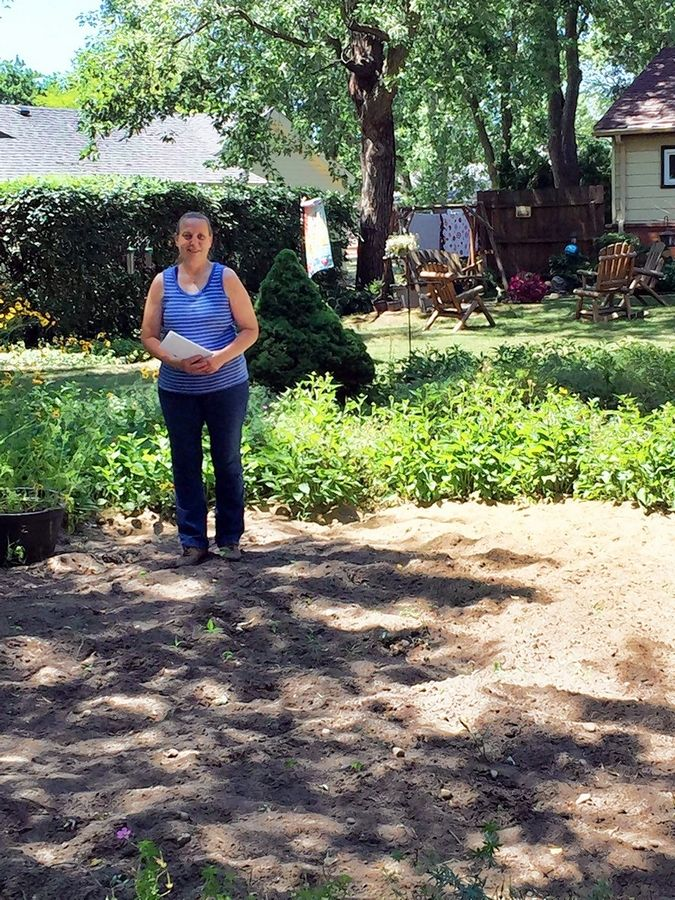 Kroes shows the spot in her overgrown yard where an aboveground pool once sat.