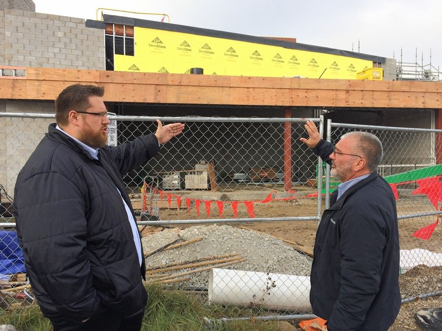 Libertyville-Vernon Hills Area High School District 128 Assistant Superintendent Dan Stanley and Building and Grounds Director Mark Koopman discuss the addition being built at Vernon Hills High School. The area behind them will be a lab for science, technology, engineering and math education.