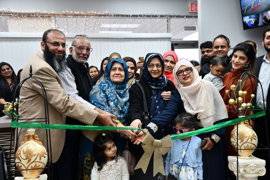Sahara Homecare President, Armaghan Rana (far left) participates in a ribbon cutting ceremony with staff and family members of company administrators on November 21, 2019.Kulsoom Khan
