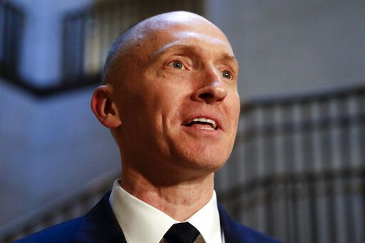 FILE - In this Nov. 2, 2017, photo, Carter Page, a foreign policy adviser to Donald Trump's 2016 presidential campaign, speaks with reporters following a day of questions from the House Intelligence Committee, on Capitol Hill in Washington.