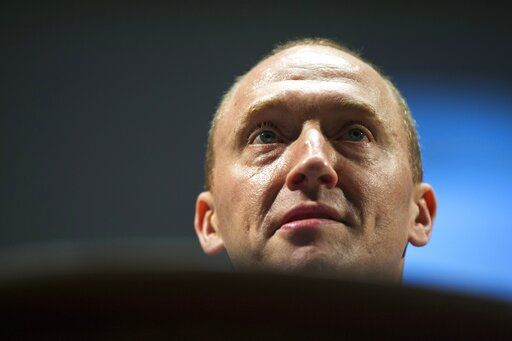 FILE - In this July 8, 2016 file photo, Carter Page, an adviser to U.S. Republican presidential candidate Donald Trump, speaks at the graduation ceremony for the New Economic School in Moscow, Russia.