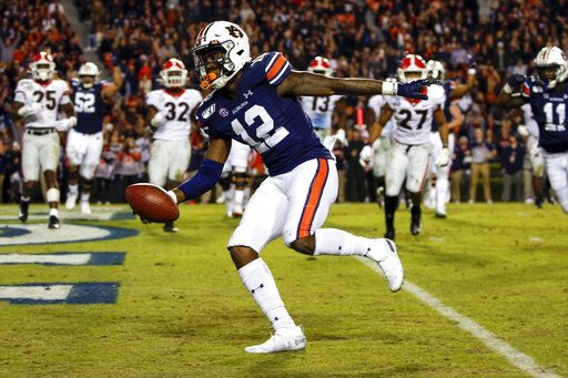 No. 16 Auburn hosts FCS Samford between rivalry game