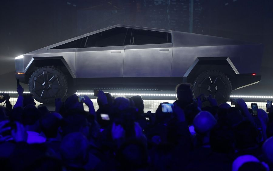 The Tesla Cybertruck is unveiled at Tesla's design studio Thursday, Nov. 21, 2019, in Hawthorne, Calif. CEO Elon Musk is taking on the workhorse heavy pickup truck market with his latest electric vehicle.