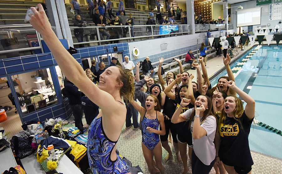 Neuqua Valley team member Jane Riehs stands in the bleachers to take a selfie with her teammates after they won the girls state swimming and diving championship at New Trier High School in Winnetka Saturday.
