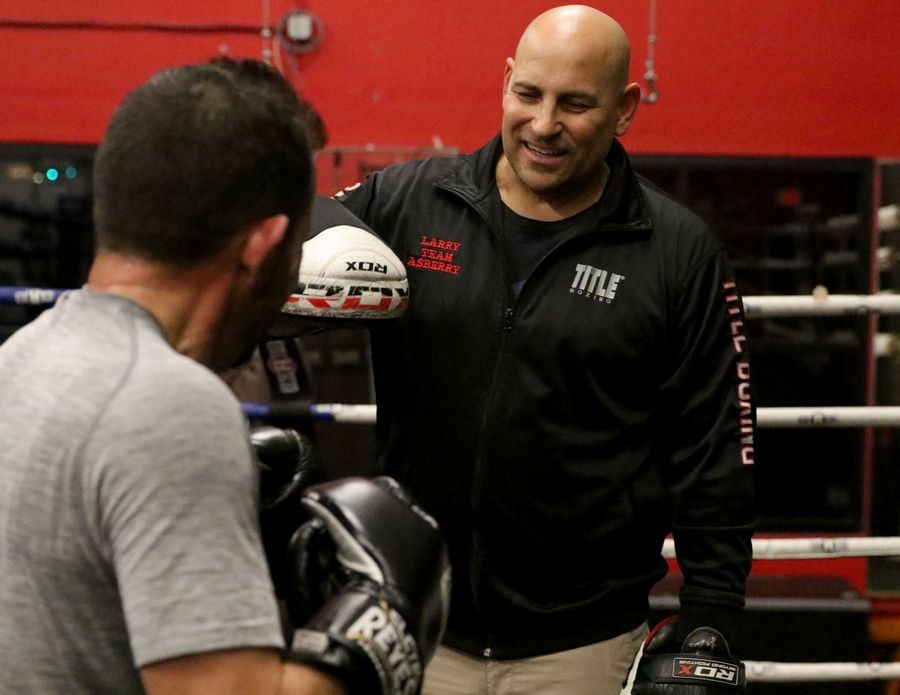 Hawthorn Woods Mayor Joe Mancino works Thursday with Conquer Fight Club owner and coach Larry Lentz at the club based in the Libertyville Sports complex.