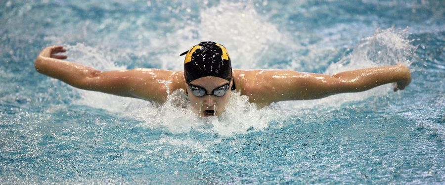 Metea Valley's McKenna Stone wins the 100-yard butterfly at the girls state swimming championships at New Trier High School in Winnetka Saturday.