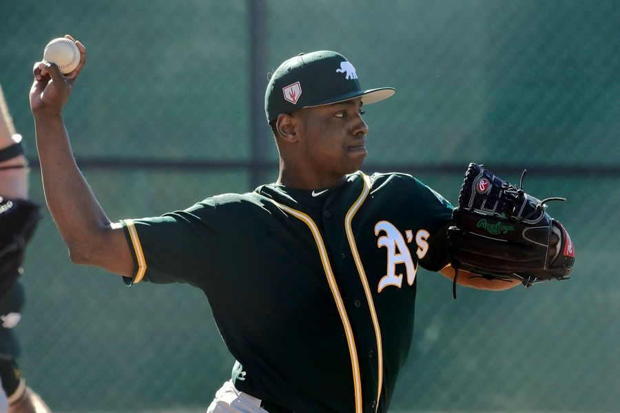 The Chicago Cubs acquired right-handed pitcher Jharel Cotton for cash considerations Saturday in a trade from the Oakland A's.