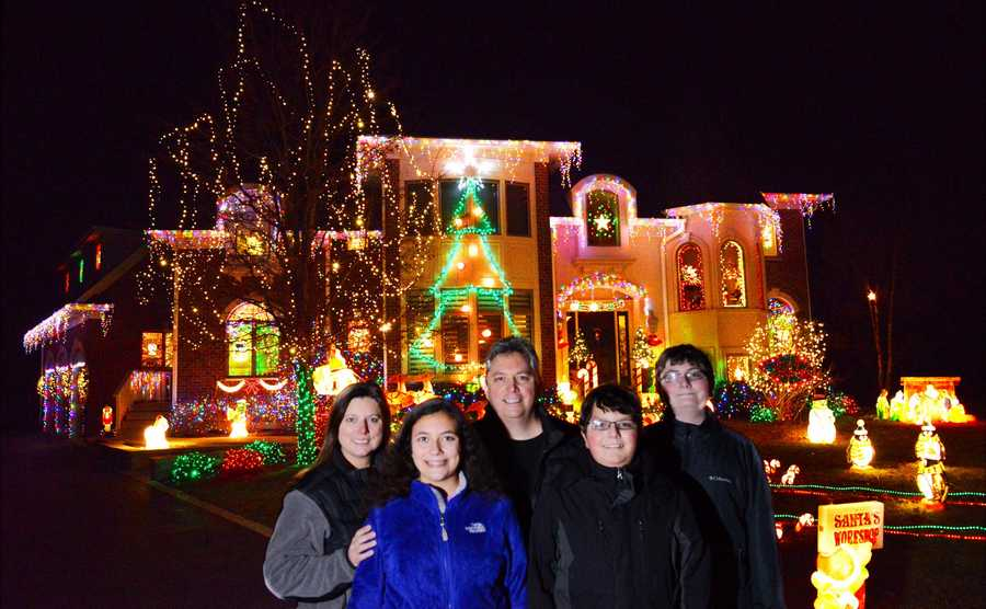 There were about 19,000 lights on the award-winning Fiadanca home at 6 Grayhawk Court in Algonquin in 2015. Here are Dante Fiandaca, his wife, Sherry, their daughter Jackie, 13, who designed the light layout, and their sons Johnny, 12, and Dante Jr., 14.