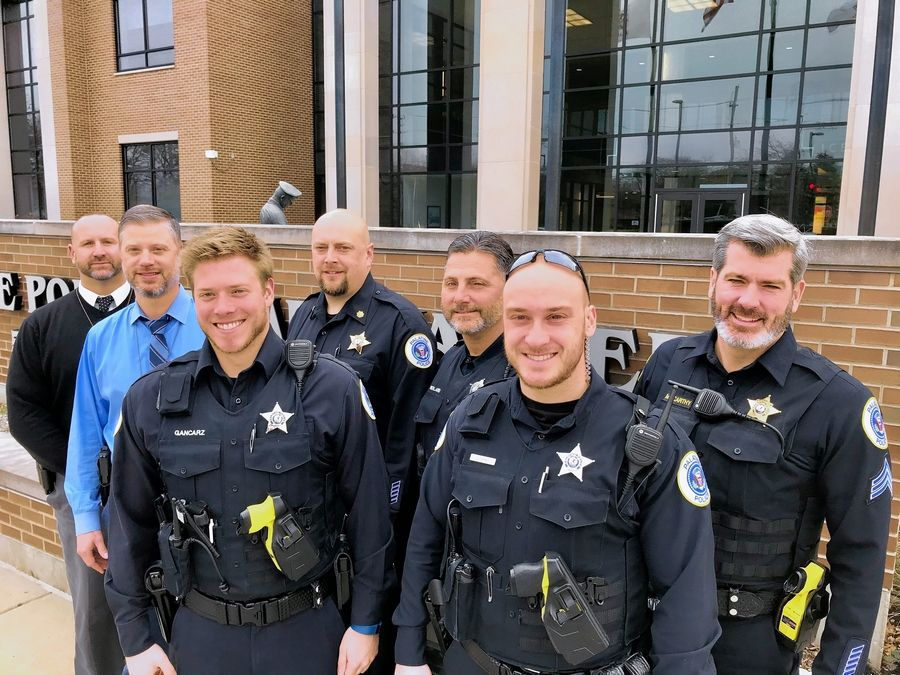 These are some of the Palatine police officers who have a few more days to break department policy by wearing beards on the job in exchange for donations to the JourneyCare hospice in Barrington in memory of colleague Mark Dahlem, who died from brain cancer there this year.