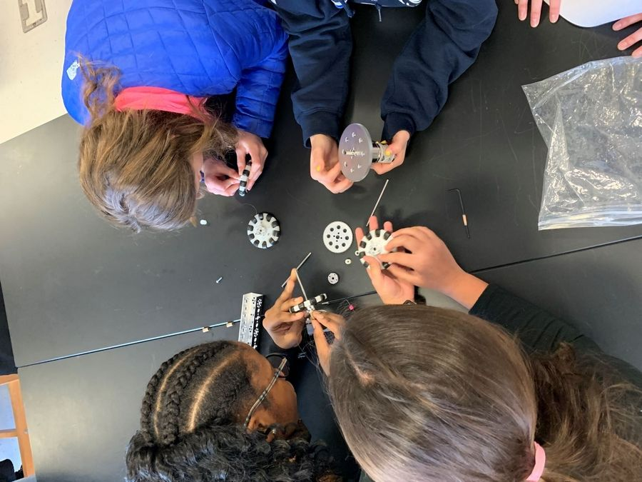Visiting middle school girls formed teams and enthusiastically engaged in hands-on cooperative activities requiring the use of creative problem-solving skills during Woodlands Academy's 4th annual robotics and engineering workshop Nov. 23.Woodlands Academy