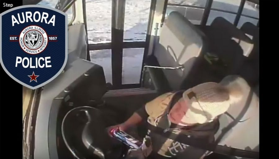 A video released by the Aurora Police Department shows a school bus driver opening a can of beer and drinking it while driving.