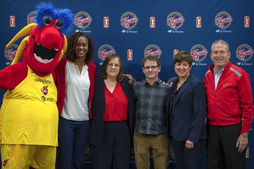 From left, Freddy Fever, Tamika Catchings, Indiana Fever vice president of basketball operations and general manager, new Fever head coach Marianne Stanley, Steve Simon, son of team owner Herb Simon, Dr. Allison Barber, Fever president and COO, and Rick Fuson, president and COO of Pacers Sports & Entertainment, pose for a portrait after a WNBA basketball press conference announcing Stanley as the seventh head coach in the Fever's 20-year WNBA history at Bankers Life Fieldhouse in Indianapolis, Tuesday, Nov. 26, 2019. (Mykal McEldowney/The Indianapolis Star via AP)