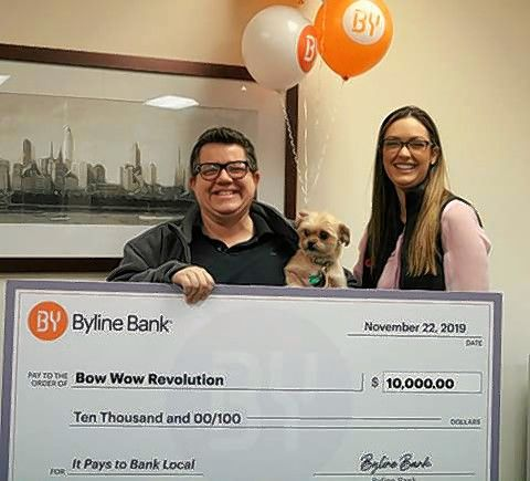 Jen Freels, left, president of Bow Wow Revolution, received the $10,000 Grand Prize award for its 2019 It Pays to Bank Local Contest from Moira Dolehide, marketing and communications manager of Byline Bank.