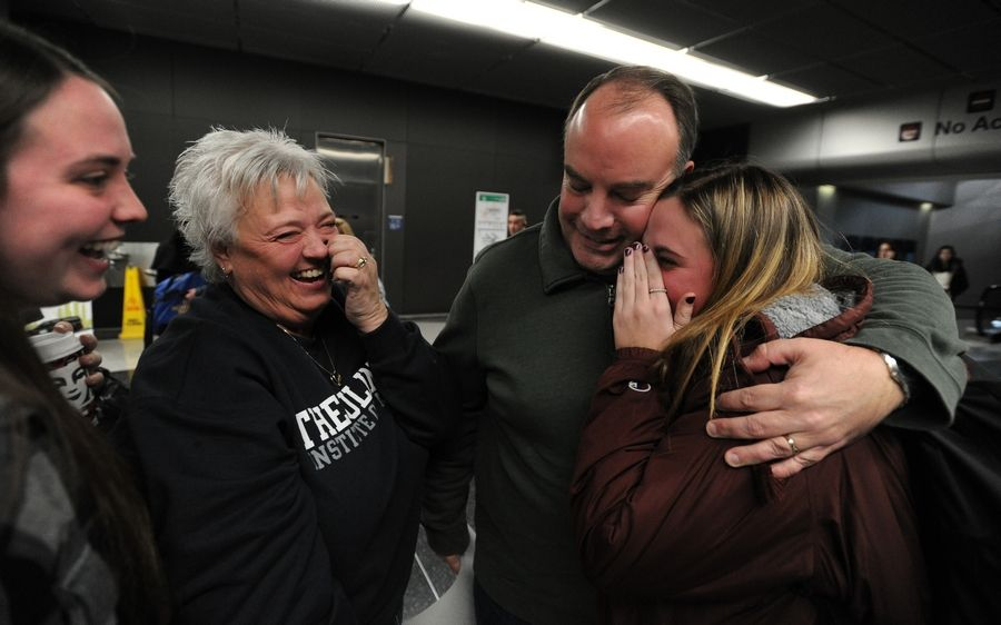 Home for Thanksgiving is where Emma Wilkinson, 18, of Lindenhurst finds herself as she hugs it out with her mom, Nancy, and her sister, Maddie, and father, Brad, in Terminal 3 at O'Hare International Airport on Wednesday.