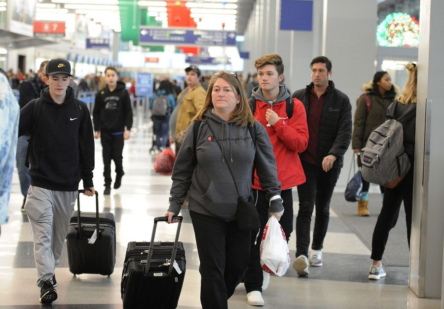 Passengers walk through the departures level of Terminal 3 at O'Hare International Airport Wednesday.