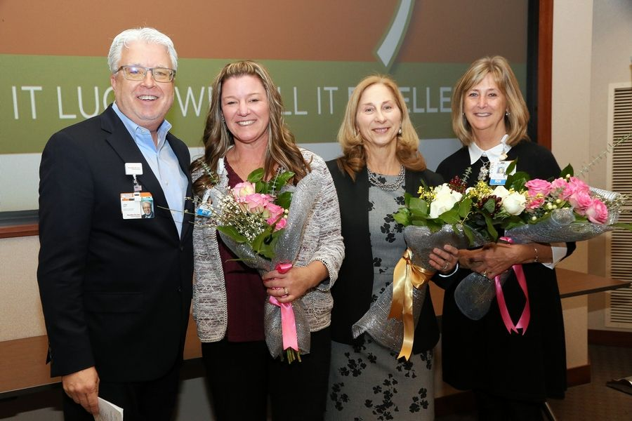 Joe Dant, president & CEO of Edward Hospital, celebrates the hospital's fourth designation as a Magnet hospital for nursing excellence from the American Nurses Credentialing Center with Denise Arp a registered nurse and clinical value analysis coordinator; Lynn Cochran, a registered nurse and chief nursing officer; and Patti Foley, a registered nurse and nursing practice manager.