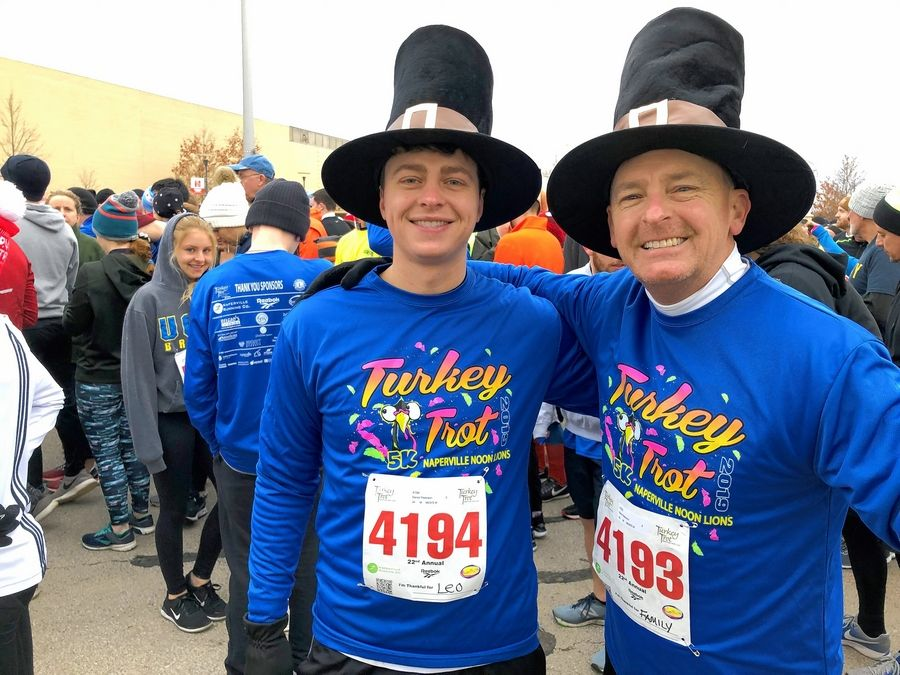 """It's amazing, all of these folks,"" Kent Peterson, with his son, Danny, said of the generation-spanning field of runners at Naperville's Turkey Trot."