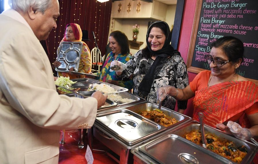 Talat Khan, second from right, is the executive director of the American Association of Retired Asians, which offers a meal program for South Asian seniors at local partner restaurants in Hanover Park, Naperville and Villa Park.