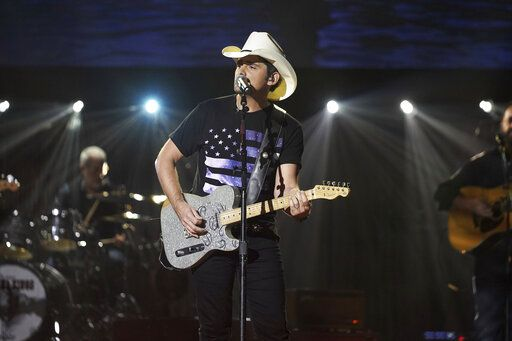 "This image released by ABC shows Brad Paisley during a taping of his variety special ""Brad Paisley Thinks He's Special,"" airing Dec. 3 at 8 p.m. EST on ABC. (Mark Levine/ABC via AP)"
