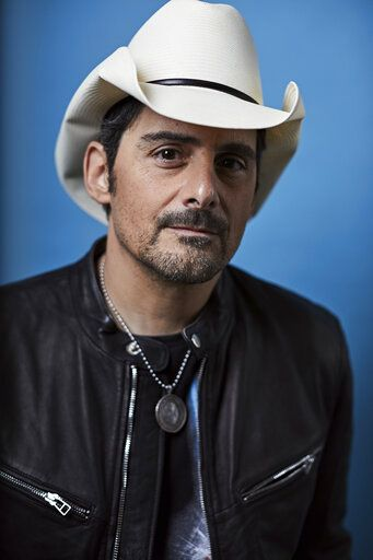 "This Nov. 18, 2019 photo shows country singer Brad Paisley posing for a portrait in New York to promote his new variety special, ""Brad Paisley Thinks He's Special,"" airing Dec. 3 at 8 p.m. EST on ABC. (Photo by Matt Licari/Invision/AP)"