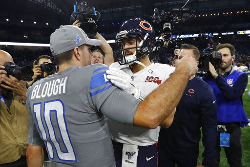 Detroit Lions quarterback David Blough, left, meets with Chicago Bears quarterback Mitchell Trubisky after an NFL football game, Thursday, Nov. 28, 2019, in Detroit.