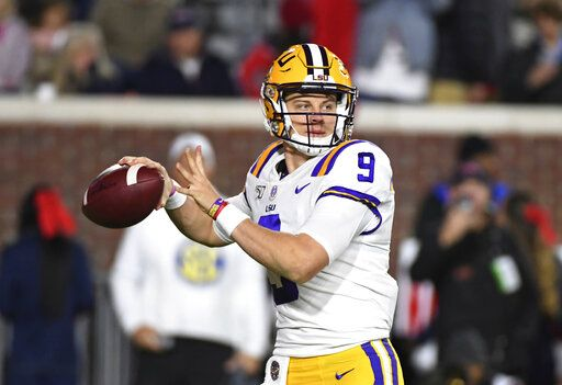 LSU quarterback Joe Burrow looks for a receiver during the first half of the team's NCAA college football game against Mississippi in Oxford, Miss., Saturday, Nov. 16, 2019.