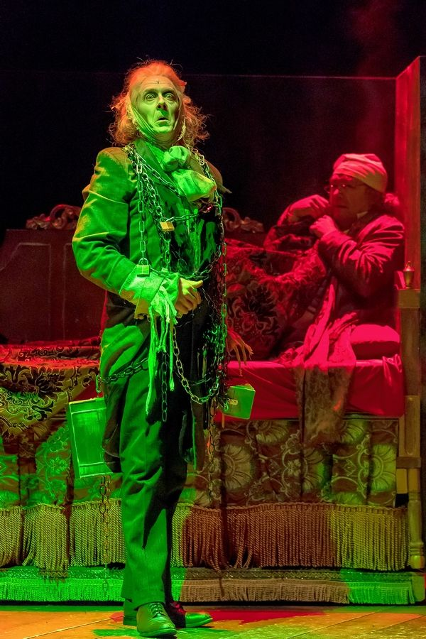 "Bradley Armacost, right, plays Ebenezer Scrooge and Derek Hassenstab plays the ghost of Jacob Marley in Drury Lane Theatre's hourlong ""A Christmas Carol"" for young audiences."