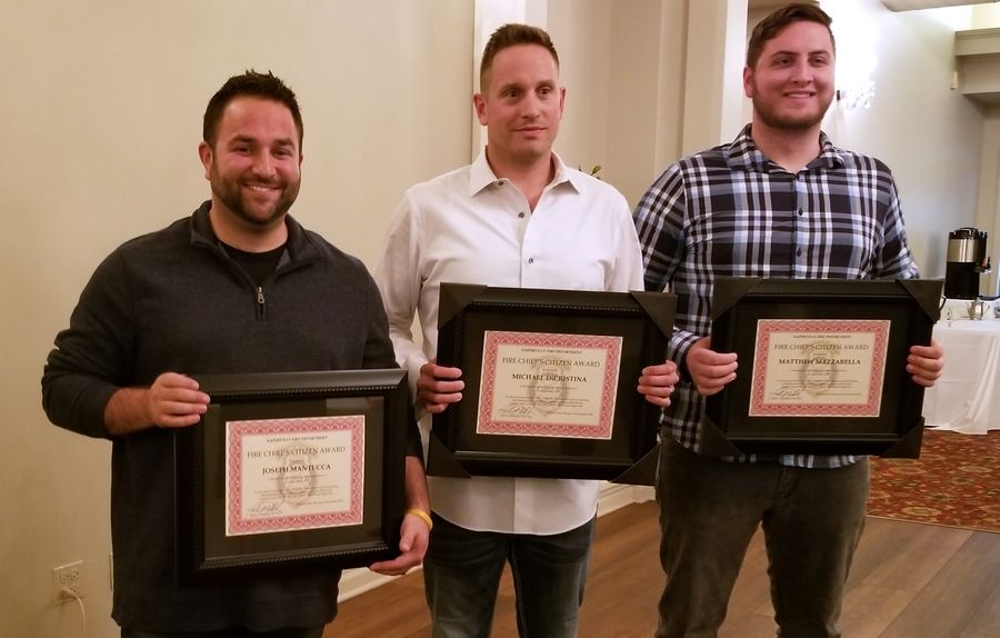 Naperville Park District park specialists Joe Mantucca, left, Mike DiCristina and former temporary employee Matthew Mazzarella were honored at the Naperville Fire Department's Nov. 18 banquet for survivors of cardiac arrest for having helped save the life of a patient on a tennis court at the Nike Sports Complex on Sept. 9.