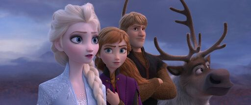 "Elsa, voiced by Idina Menzel, left, Anna, voiced by Kristen Bell, Kristoff, voiced by Jonathan Groff and Sven in ""Frozen 2."""