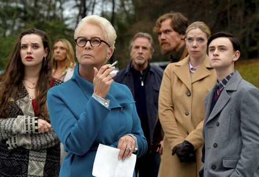 "This image released by Lionsgate shows Katherine Langford, from left, Toni Collette, Jamie Lee Curtis, Don Johnson, Michael Shannon, Riki Lindholm and Jaeden Lieberher in a scene from ""Knives Out."" (Claire Folger/Lionsgate via AP)"