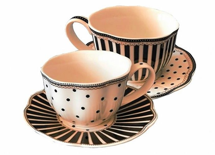 "Ticket holders for the annual Cup of Cheer Dec. 5-6 receive a commemorative teacup and saucer at the tea. This year's teacup, called ""Josephine Black,"" comes in two variations of dots and strips."
