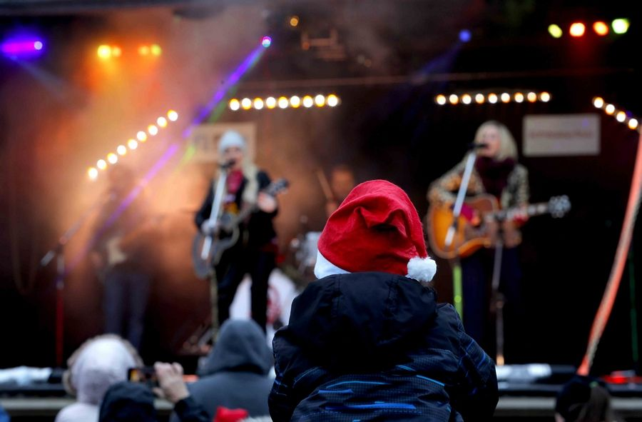 A youngster dons a Santa cap as Meghan Patrick sings Monday in Bensenville.
