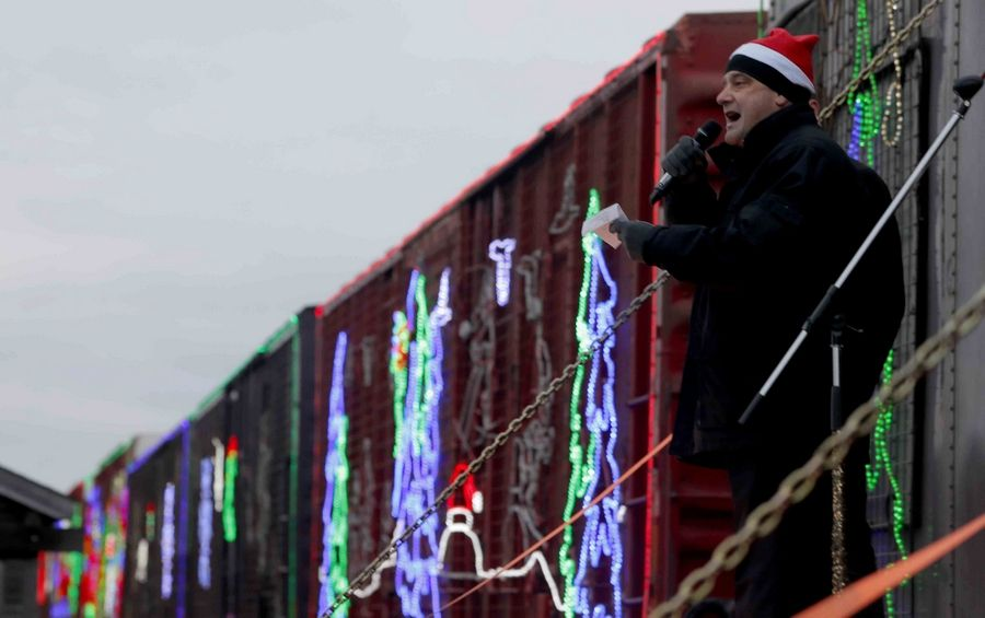Bensenville Village President Frank DeSimone speaks on Monday. For the second year, Bensenville was visited Monday by the Canadian Pacific Rail Holiday Train.