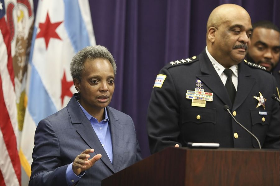 "Mayor Lori Lightfoot, shown her in November as Chicago Police Superintendent Eddie Johnson announced his retirement, fired Johnson Monday due to his ""ethical lapses."""