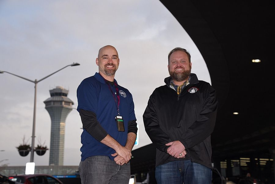Ryan Schile, left, of Arlington Heights and Andrew Rice of Wheaton are air traffic controllers at O'Hare International Airport in Chicago. They kept two planes from colliding there in March.